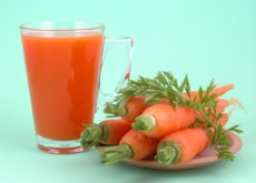 just carrots and glass of carrot juice